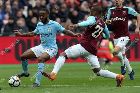 Patrice Evra of West Ham United and Raheem Sterling of Manchester City during West Ham United vs Manchester City, Premier League Football at The London Stadium on 29th April 2018