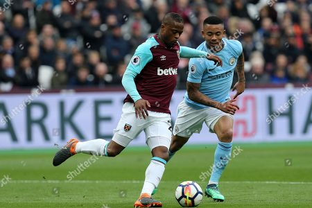 Patrice Evra of West Ham United and Gabriel Jesus of Manchester City during West Ham United vs Manchester City, Premier League Football at The London Stadium on 29th April 2018