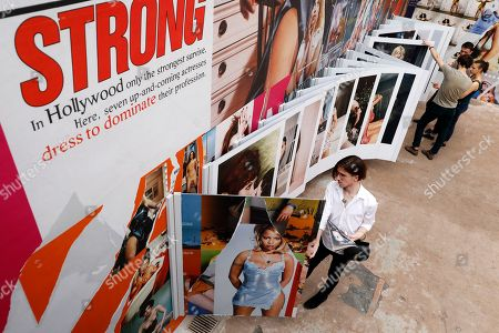 Stock Photo of People visit the exhibition 'Bettina and Bill L.A. 94/97' dedicated to French photographer Bettina Rheims during the 33rd International Festival of Fashion and Photography, in Hyeres, southern France, 29 April 2018.