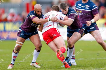 Leeds Rhinos second row Jamie Jones-Buchanan (11) and Leeds Rhinos second row Stevie Ward (13) stop Hull Kingston Rovers winger Ryan Shaw (5)  during the Betfred Super League match between Hull Kingston Rovers and Leeds Rhinos at the Lightstream Stadium, Hull. Picture by Simon Davies