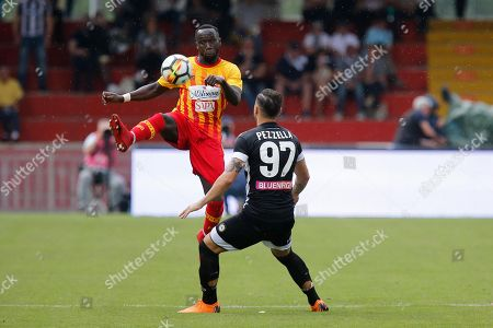 Benevento's Bacary Sagna (L) and Udinese's Giuseppe Pezzella in action during the Italian Serie A soccer match between Benevento Calcio and Udinese Calcio at Ciro Vigorito stadium in Benevento, Italy, 29 April 2018.