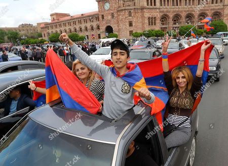 Protesters hold Armenian national flags as they gather at Republic Square in Yerevan, Armenia, . Opposition leader Nikol Pashinian said Sunday that he hopes President Armen Sarkisian will support Pashinian's bid to become prime minister. The parliament is to choose a new premier on Tuesday, following the resignation last week of Serzh Sargsyan