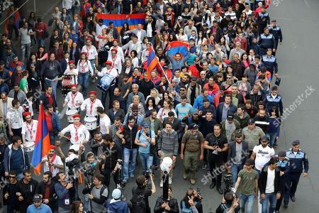 Protesters march to Republic Square in Yerevan, Armenia, . Nikol Pashinian said Sunday that he hopes President Armen Sarkisian will support Pashinian's bid to become prime minister. The parliament is to choose a new premier on Tuesday, following the resignation last week of Serzh Sargsyan