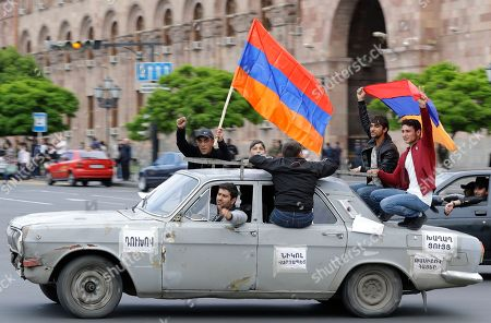 Protesters hold Armenian national flags as they gather at Republic Square in Yerevan, Armenia, . The leader of the wave of protests that has pushed Armenia into a political crisis says he has met with the country's president. Nikol Pashinian said Sunday that he hopes President Armen Sarkisian will support Pashinian's bid to become prime minister. The parliament is to choose a new premier on Tuesday, following the resignation last week of Serzh Sargsyan