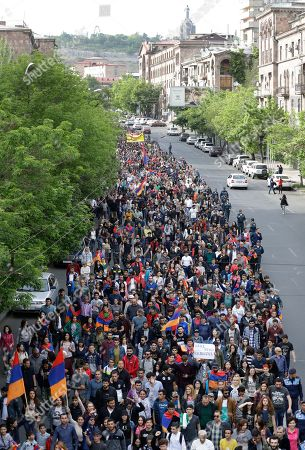 Protesters march to Republic Square in Yerevan, Armenia, . The leader of the wave of protests that has pushed Armenia into a political crisis says he has met with the country's president. Nikol Pashinian said Sunday that he hopes President Armen Sarkisian will support Pashinian's bid to become prime minister. The parliament is to choose a new premier on Tuesday, following the resignation last week of Serzh Sargsyan