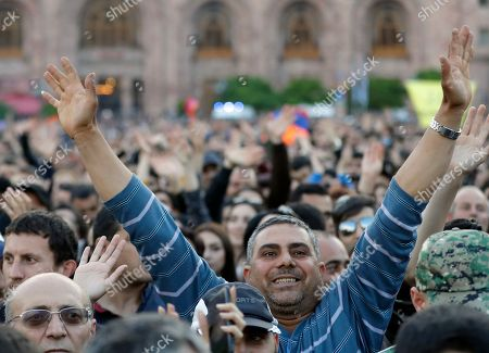 Stock Image of Protesters react while listening to their leader Nikol Pashinian during a rally in Yerevan, Armenia, . The leader of the wave of protests that has pushed Armenia into a political crisis says he has met with the country's president. Pashinian said Sunday that he hopes President Armen Sarkisian will support Pashinian's bid to become prime minister. The parliament is to choose a new premier on Tuesday, following the resignation last week of Serzh Sargsyan