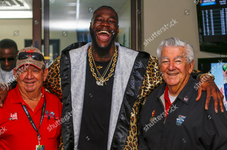 WBC Heavyweight Champion Deontay Wilder, center, poses with Donnie Allison, left, and Bobby Allison before the GEICO 500 NASCAR Talladega auto race at Talladega Superspeedway, in Talladega, Ala