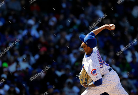 Chicago Cubs relief pitcher Carl Edwards Jr., throws during the eighth inning of a baseball game against the Milwaukee Brewers, in Chicago. The Cubs won 2-0