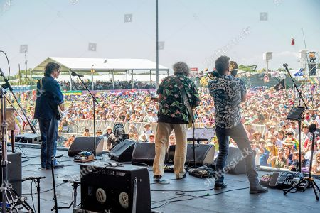 Stock Image of Tom Malone, Dave Malone, Mark Mullins. Tom Malone, from left, Dave Malone and Mark Mullins of the Magnificent 7 perform at the New Orleans Jazz and Heritage Festival, in New Orleans