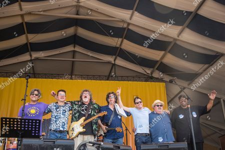 Michael Skinkus, Mark Mullins, Dave Malone, Tom Malone, Robert Mercurio, John Gros, Raymond Weber. Michael Skinkus, from left, Mark Mullins, Dave Malone, Tom Malone, Robert Mercurio, John Gros, Raymond Weber of the Magnificent 7 performs at the New Orleans Jazz and Heritage Festival, in New Orleans