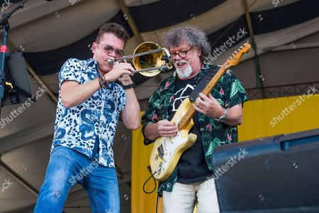 Mark Mullins, Dave Malone. Mark Mullins, left, and Dave Malone of the Magnificent 7 perform at the New Orleans Jazz and Heritage Festival, in New Orleans