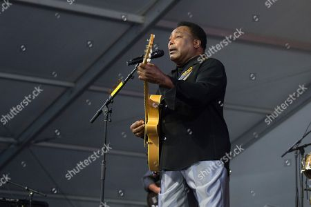 Stock Photo of George Benson performs at the New Orleans Jazz and Heritage Festival, in New Orleans