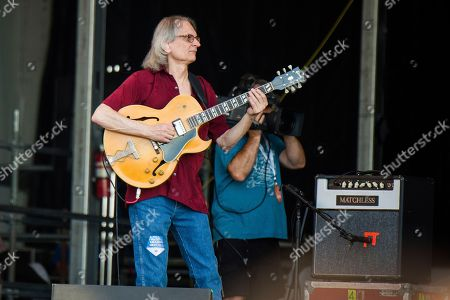 Sonny Landreth, Jimmy Buffett. Sonny Landreth performs with Jimmy Buffett at the New Orleans Jazz and Heritage Festival, in New Orleans