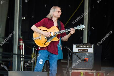 Stock Photo of Sonny Landreth, Jimmy Buffett. Sonny Landreth performs with Jimmy Buffett at the New Orleans Jazz and Heritage Festival, in New Orleans