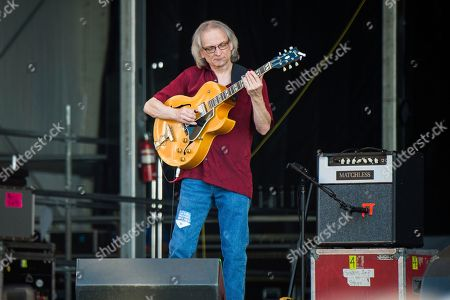 Stock Image of Sonny Landreth, Jimmy Buffett. Sonny Landreth performs with Jimmy Buffett at the New Orleans Jazz and Heritage Festival, in New Orleans
