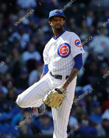 Chicago Cubs relief pitcher Carl Edwards Jr., stretches during the eighth inning of a baseball game against the Milwaukee Brewers, in Chicago. The Cubs won 2-0