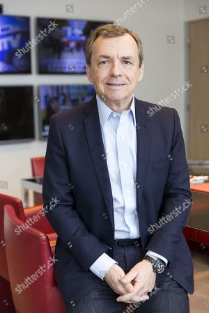 Alain Weill, Chairman and Chief Executive Officer of SFR Group, Chief Operating Officer of Altice Media and Chief Executive Officer of SFR Media, in his office