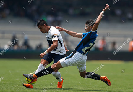 Pumas' Pablo Barrera, behind left, fights for the ball with Queretaro's Alexis Perez during a Mexican soccer league match in Mexico City, . Pumas and Queretaro tied 1-1