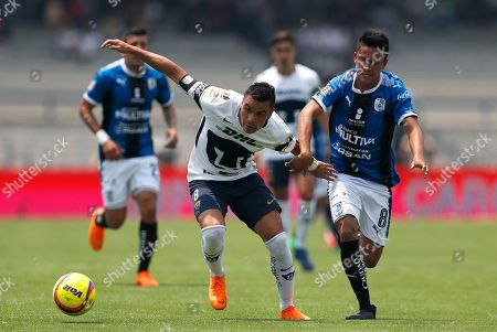 Pumas' Pablo Barrera, front left, fights for the ball with Queretaro's Aldo Arellano during a Mexican soccer league match in Mexico City, . Pumas and Queretaro tied 1-1
