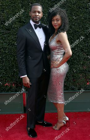 Stock Picture of Anthony Montgomery, Vinessa Antoine. Anthony Montgomery, left, and Vinessa Antoine arrive