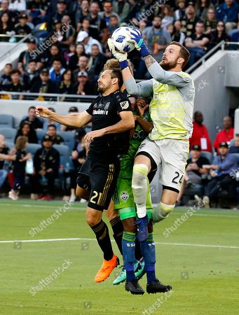 Seattle Sounders goalkeeper Stefan Frei (24), of Switzerland, catches the ball against Los Angeles FC forward Marco Urena (21), of Costa Rica, in the first half of an MLS soccer game at Banc of California Stadium in Los Angeles