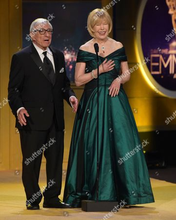 "Jamie Farr, Loretta Swit. Jamie Farr, left, and Loretta Swit present a tribute to ""Mr. Rogers"" at the 45th annual Daytime Emmy Awards at the Pasadena Civic Center, in Pasadena, Calif"