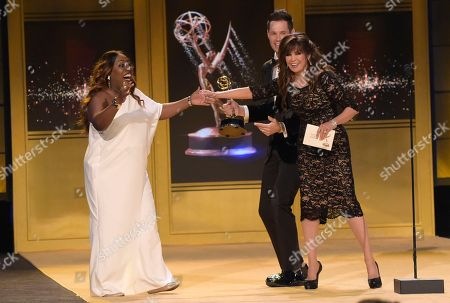 """Sheryl Underwood, Marie Osmond, David Osmond. Sheryl Underwood, left, reacts as Marie Osmond, from right, and David Osmond present """"The Talk"""" with the award for outstanding entertainment talk show at the 45th annual Daytime Emmy Awards at the Pasadena Civic Center, in Pasadena, Calif"""
