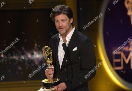 "Greg Vaughn accepts the award for outstanding supporting actor in a drama series for ""Days of Our Lives"" at the 45th annual Daytime Emmy Awards at the Pasadena Civic Center, in Pasadena, Calif"