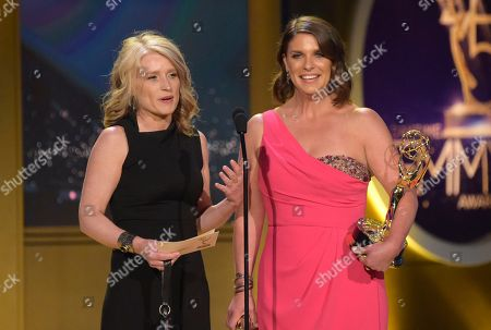 """Cynthia Hill, Vivian Howard. Cynthia Hill, left, and Vivian Howard accept the award for outstanding culinary program for """"A Chef's Life"""" at the 45th annual Daytime Emmy Awards at the Pasadena Civic Center, in Pasadena, Calif"""