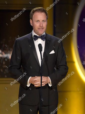 Chris Harrison presents the award for outstanding entertainment talk show host at the 45th annual Daytime Emmy Awards at the Pasadena Civic Center, in Pasadena, Calif