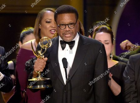 """Greg Mathis accepts the award for outstanding legal/courtroom program for """" Judge Mathis """" at the 45th annual Daytime Emmy Awards at the Pasadena Civic Center, in Pasadena, Calif"""