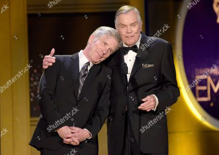 Tom Bergeron, Peter Marshall. Tom Bergeron, left, rests his head on Peter Shoulder as they present an award at the 45th annual Daytime Emmy Awards at the Pasadena Civic Center, in Pasadena, Calif