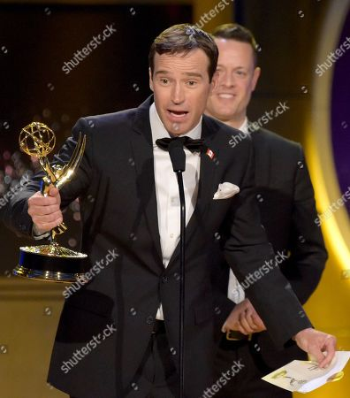 """Stock Photo of Mike Richards accepts the award for outstanding game show for """"The Price is Right"""" at the 45th annual Daytime Emmy Awards at the Pasadena Civic Center, in Pasadena, Calif"""