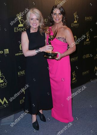 """Stock Picture of Cynthia Hill, Vivian Howard. Cynthia Hill, left, and Vivian Howard pose in the press room with the award for outstanding culinary program for """"A Chef's Life"""""""