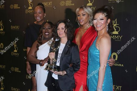 """Aisha Tyler, Sheryl Underwood, Sara Gilbert, Eve, Julie Chen. Aisha Tyler, from left, Sheryl Underwood, Sara Gilbert, Eve and Julie Chen pose in the press room with he award for outstanding entertainment talk show for """"The Talk"""""""