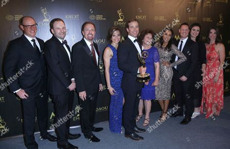 """Stock Image of Mike Richards, fifth from left, and the crew of """"The Price is Right"""" pose in the press room with the award for outstanding game show"""