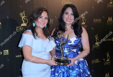 "Natali Monterrosa, Alejandra Oraa. Natali Monterrosa, left, and Alejandra Oraa pose in the press room with the award for outstanding entertainment program in Spanish for ""Destinos"""