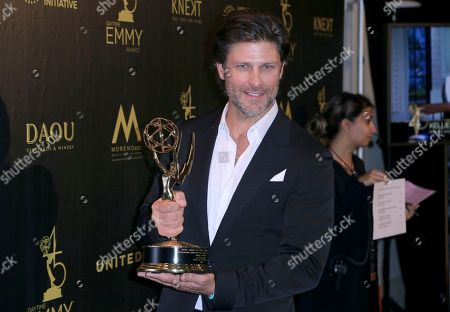 "Greg Vaughn poses in the press room with the award for outstanding supporting actor in a drama series for ""Days of Our Lives"""