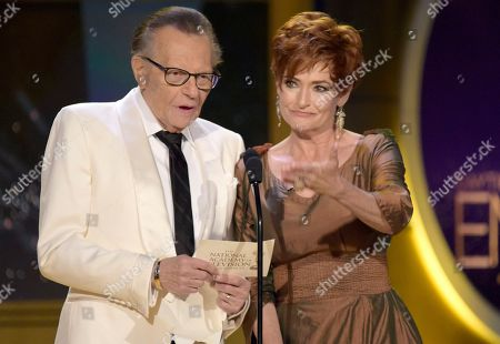 Larry King, Carolyn Hennesy. Larry King, left, and Carolyn Hennesy present the award for outstanding drama series writing team at the 45th annual Daytime Emmy Awards at the Pasadena Civic Center, in Pasadena, Calif