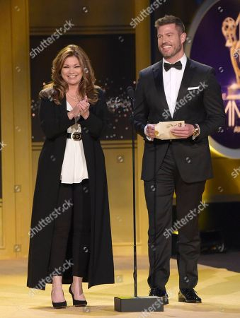 Valerie Bertinelli, Jesse Palmer. Valerie Bertinelli, left, and Jesse Palmer present the award for outstanding informative talk show host at the 45th annual Daytime Emmy Awards at the Pasadena Civic Center, in Pasadena, Calif