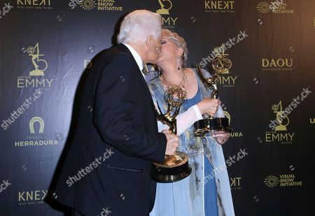 Stock Image of Bill Hayes, Susan Seaforth Hayes. Bill Hayes, left, and Susan Seaforth Hayes kiss as they pose in the press room with the lifetime achievement award