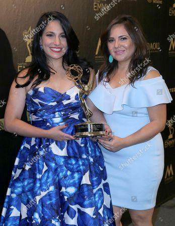 "Alejandra Oraa, Natali Monterrosa. Alejandra Oraa, left, and Natali Monterrosa pose in the press room with he award for outstanding entertainment program in Spanish for ""Destinos"""