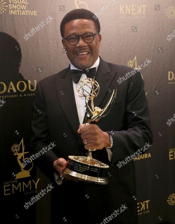 "Greg Mathis poses in the press room with the award for outstanding legal/courtroom program for "" Judge Mathis """