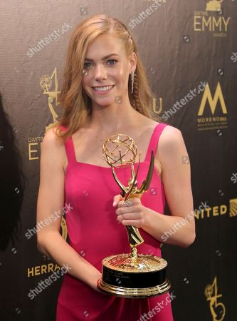 "Chloe Lanier poses in the press room with the award for outstanding younger actress in a drama series for ""General Hospital"""