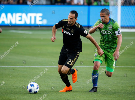 Los Angeles FC forward Marco Urena (21) of Costa Rica, vies with Seattle Sounders midfielder Osvaldo Alonso (6) of Cuba, in the first half of an MLS soccer game at Banc of California Stadium in Los Angeles