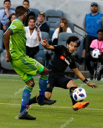 Los Angeles FC defender Omar Gaber (4) of Egypt, in actions against Seattle Sounders of Cameroon, in the first half of an MLS soccer game at Banc of California Stadium in Los Angeles