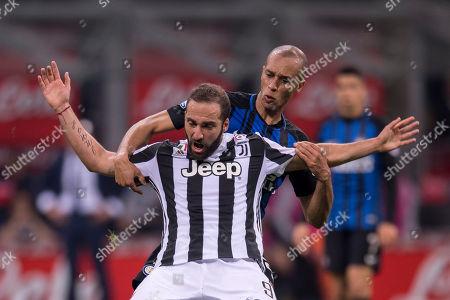 Gonzalo Gerardo Higuain of Juventus and Joao Miranda de Souza Filho of Inter