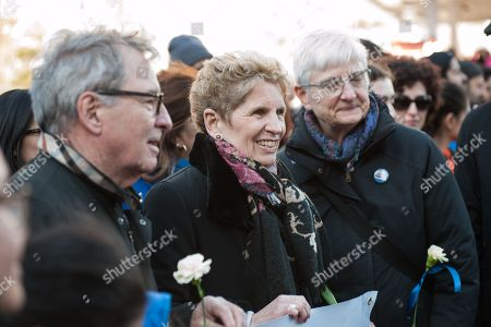 Ontario Premier Kathleen Wynne interacts with marchers as they reclaim Yonge Street after the violence of the Toronto Van Attack.