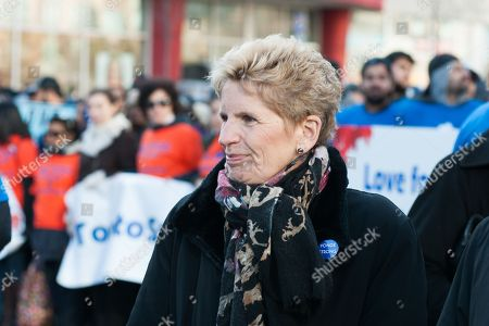 Stock Picture of Ontario Premier Kathleen Wynne interacts with marchers as they reclaim Yonge Street after the violence of the Toronto Van Attack.