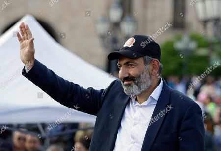 Armenian protest leader Nikol Pashinian waves during a rally in Yerevan on . Armenia's parliament plans to choose a replacement on Tuesday for Serzh Sargsyan, who resigned last week amid the street demonstrations over his selection as prime minister. Pashinian, who led the protests, hopes to be the next premier